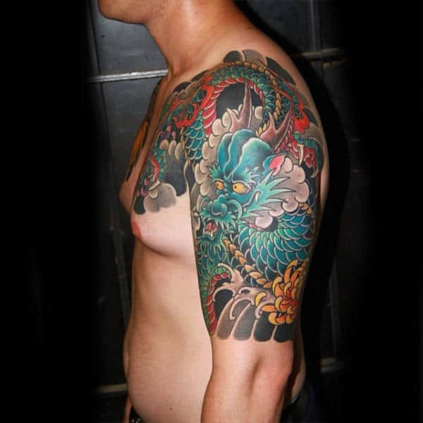 Guy With Celestial Dragon Tattoo Sleeves