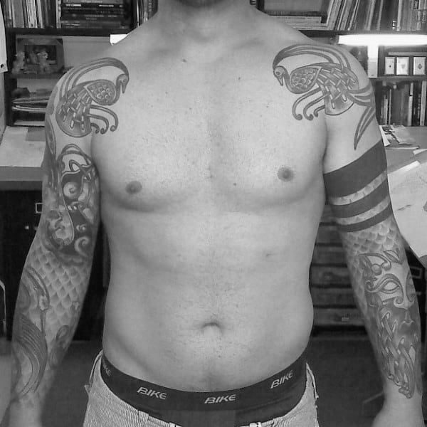 Guy With Celtic Themed Half Sleeve Tattoos On Both Arms
