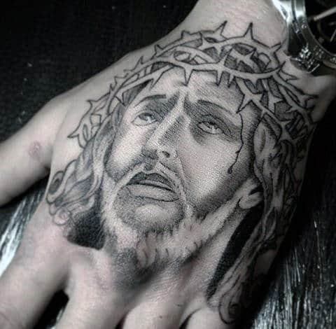 Guy With Christian Jesus Christ Tattoo Design On Hand