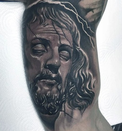 Guy With Christian Symbols Tattoo