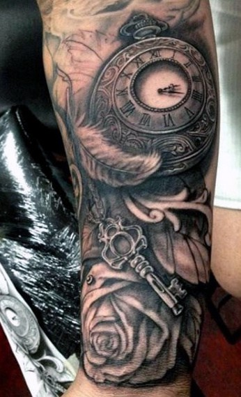 Guy With Clock And Feather Tattoo On Arms