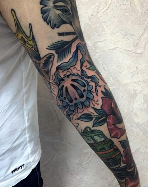 Guy With Colored Jellyfish Tattoo Arms
