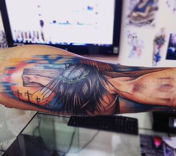 Guy With Colored Religious Tattoo On Arms