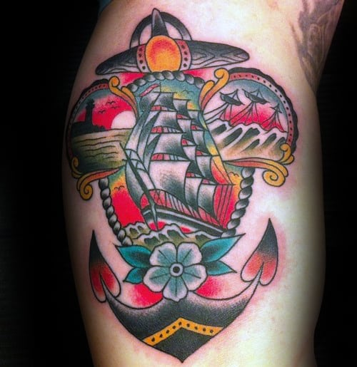 Guy With Colorful Traditional Anchor Ship Arm Bicep Tattoos
