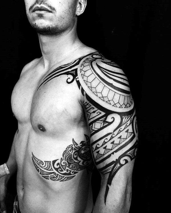 Guy With Cool Unique Tribal Rib Polynesian Tattoos