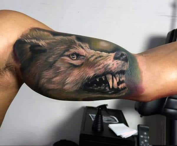 Guy With Cool Watercolor Wolf Inner Arm Tattoo