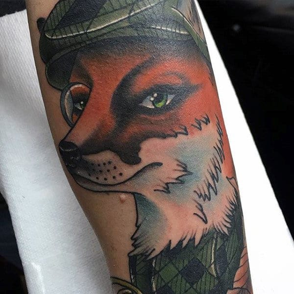 Guy With Crafty Female Fox Tattoo On Forearms