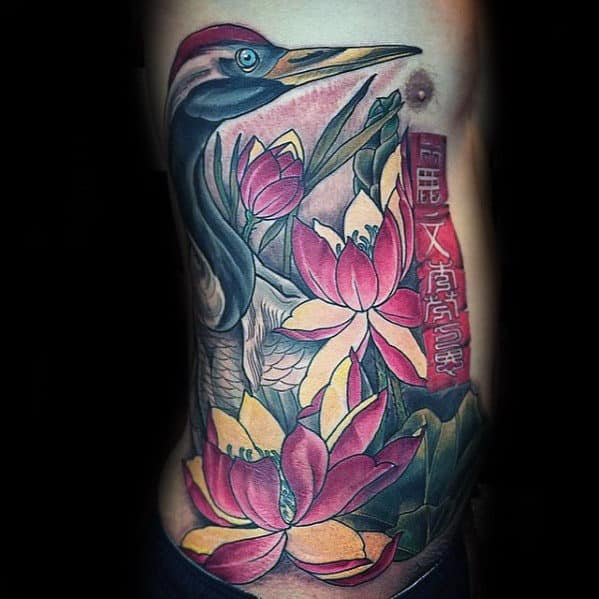 Guy With Crane And Flowers Full Rib Cage Side Tattoo