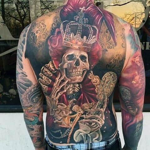 Guy With Crowned Skeleton And Red Feathers Tattoo Full Back