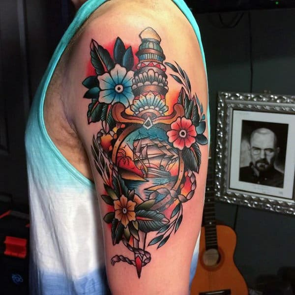 Guy With Dagger And Flowers Tattoo