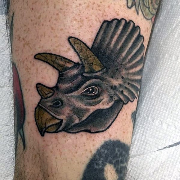 Guy With Dinosaur Tattoo On Ankle
