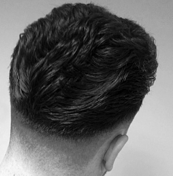 Guy With Ducktails Hairstyle Low Fade