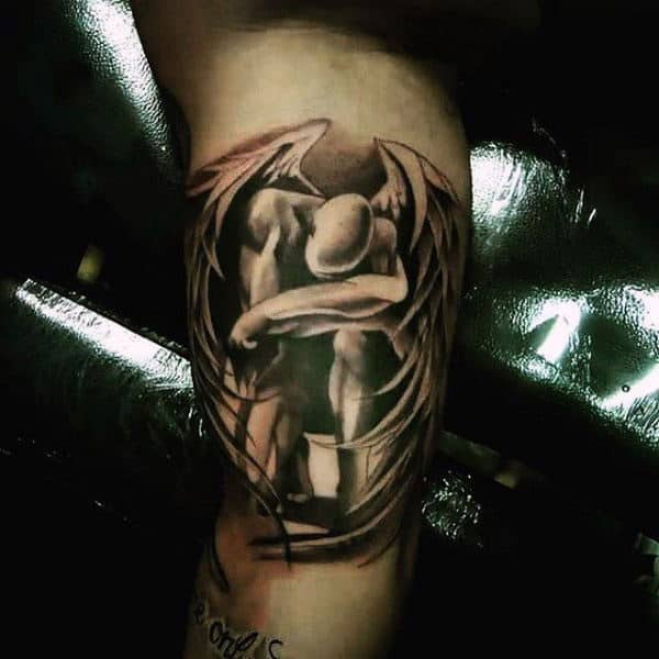 Guy With Fallen Guardian Angel Tattoo On Arms