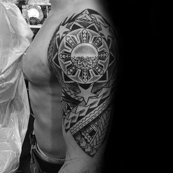 Guy With Filipino Sun Tattoo Design Half Sleeve
