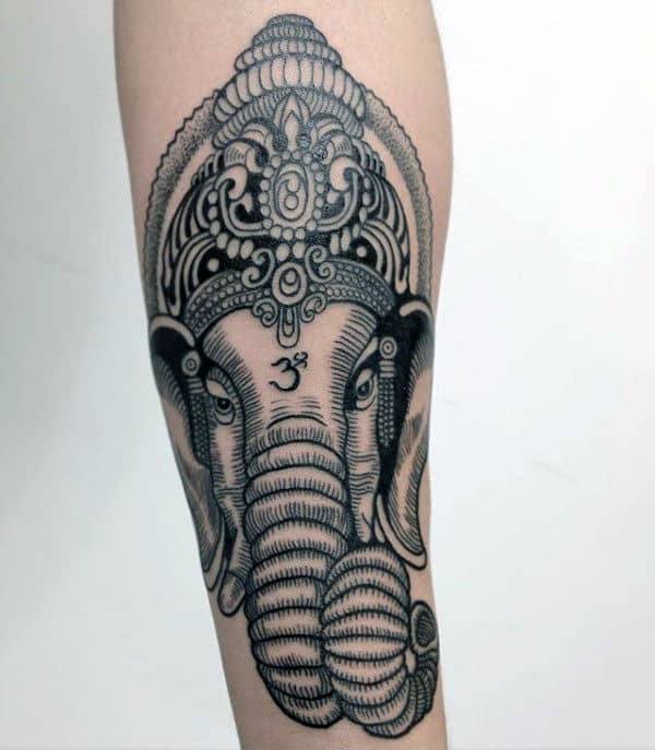 Guy With Forearm Tattoo Design Of Ganesha