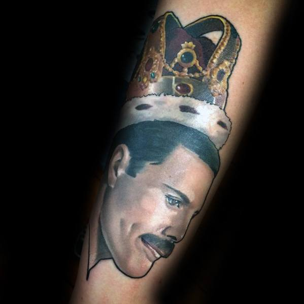 Guy With Freddie Mercury Crown Forearm Tattoo Design