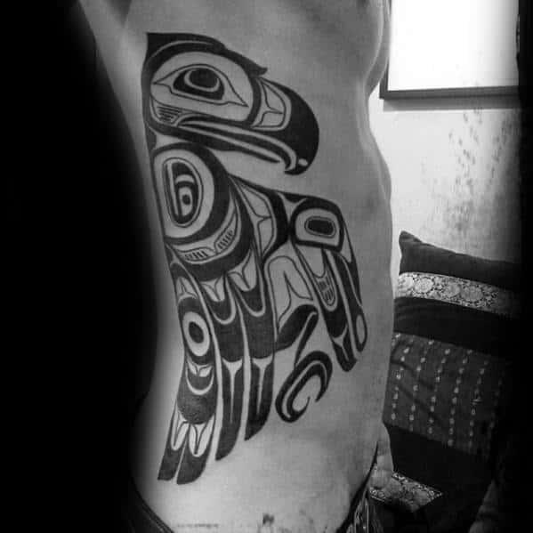 Guy With Full Rib Cage Side Tribal Bird Haida Tattoo