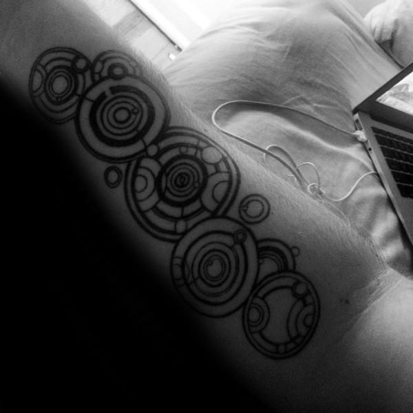 Guy With Gallifreyan Themed Inner Forearm Tattoo Design