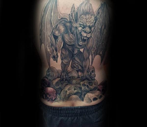 Guy With Gargoyle Skull Back Tattoo