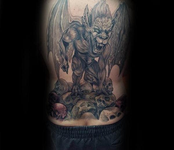 Guy With Gargoyle Skull Back Tattoo