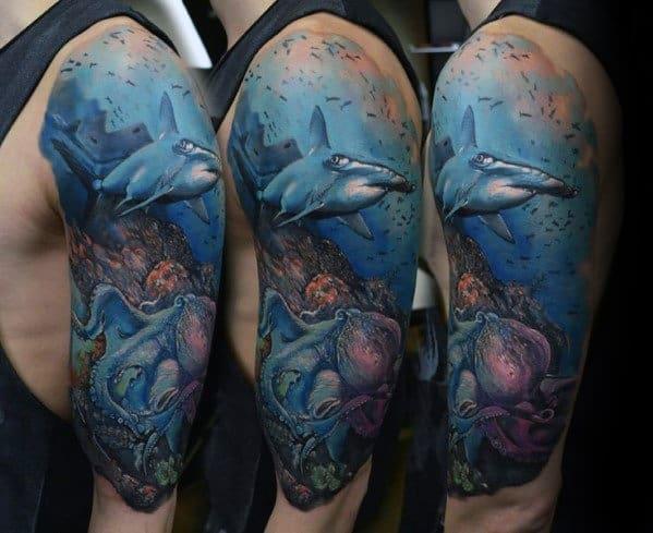 Guy With Half Sleeve Shark Ocean Tattoo Design
