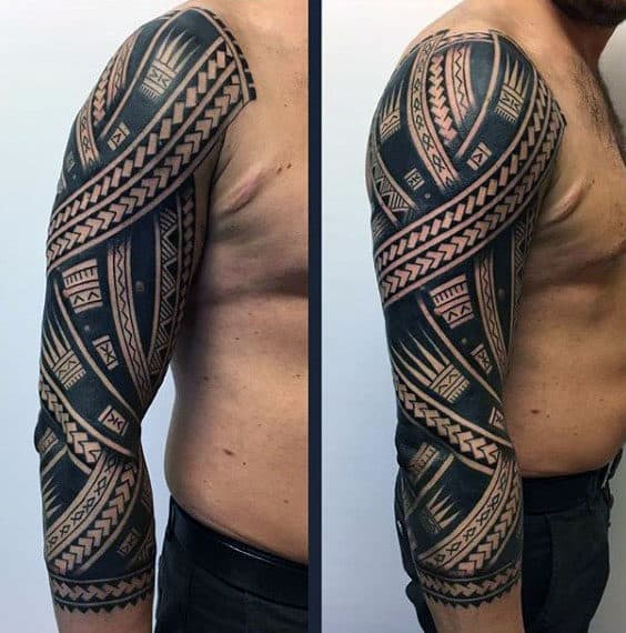 Guy With Half Sleeve Upper Arm Tribal Tattoos