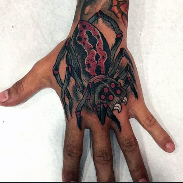 Guy With Hideous Spider Tattoo On Hands