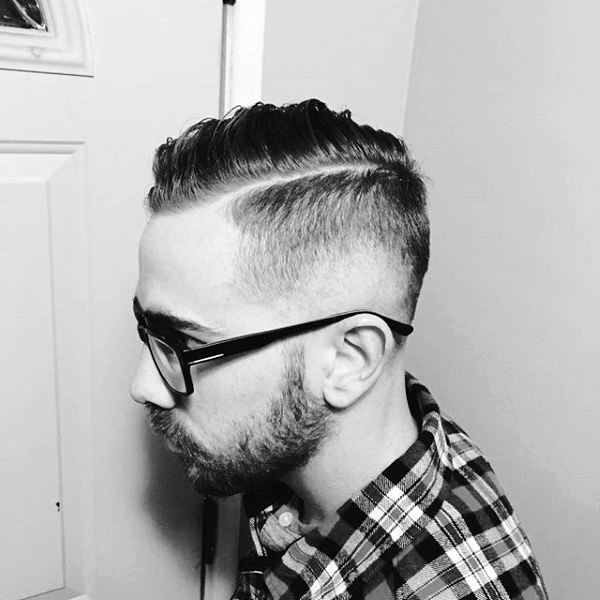 Guy With High Fade Comb Over Hair