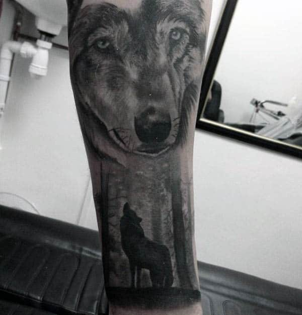 Guy With Howling Wolf Silhouette Forest Tattoo On Forearms