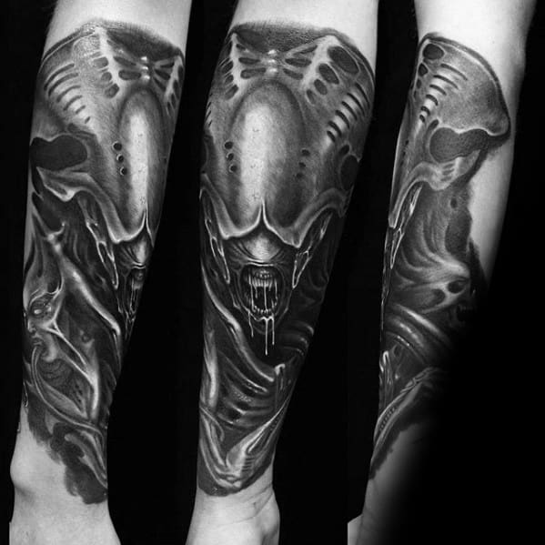 Guy With Hr Giger Tattoo Design