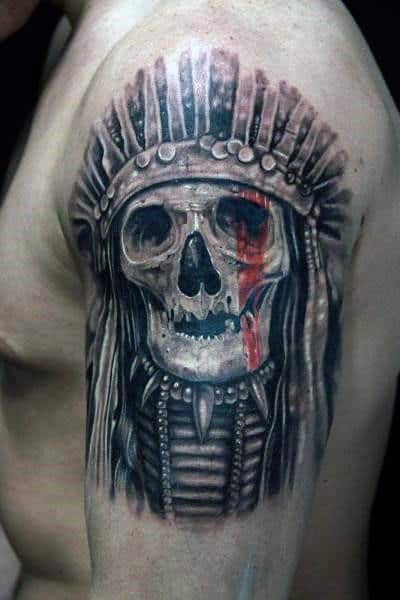 Guy With Indian Skull Chief Tattoo On Upper Arms