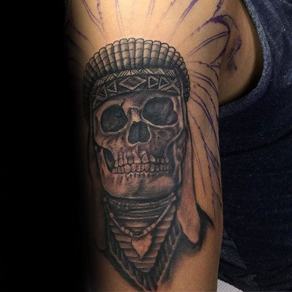 Guy With Indian Skull Upper Arm Tattoo In Shaded Grey Ink