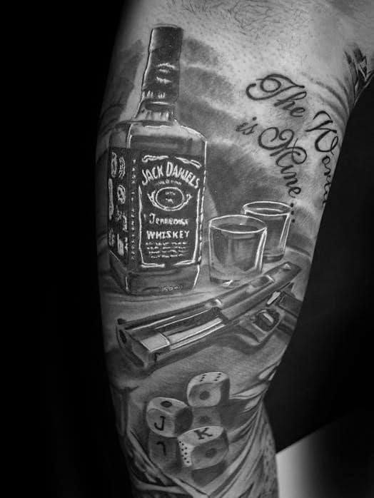 Guy With Jack Daniels Table Tattoo On Arm