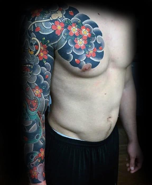 Guy With Japanese Flower And Clouds Tattoo On Chest