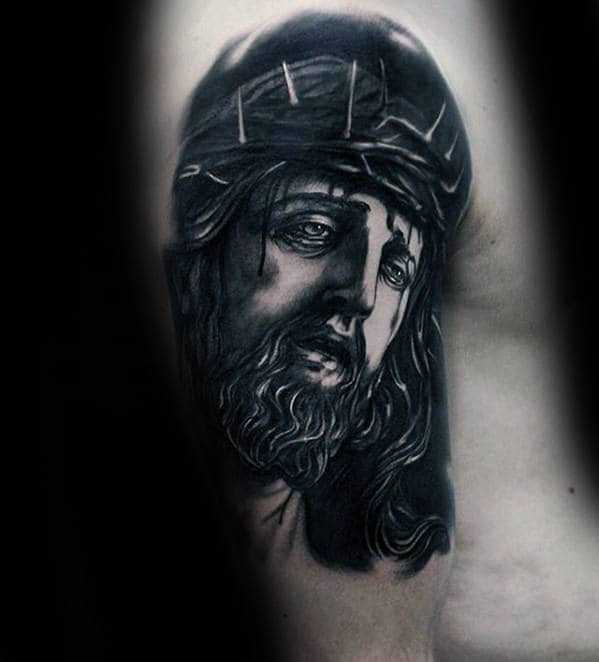 Guy With Jesus Dark Black Ink Shaded Arm Tattoo