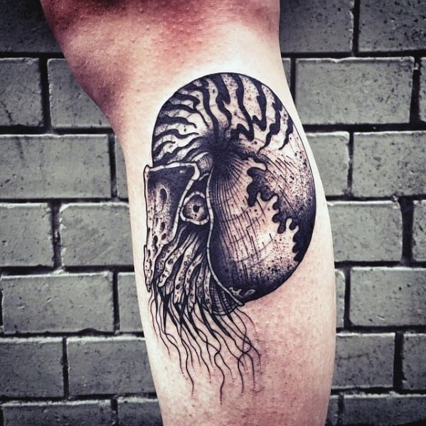 Guy With Leg Ammonite Tattoo Design