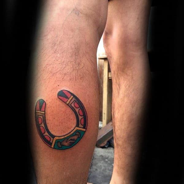 Guy With Leg Calf Tattoo Design Of Horseshoe