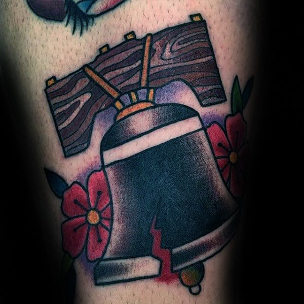 Guy With Liberty Bell Old School Arm Tattoo