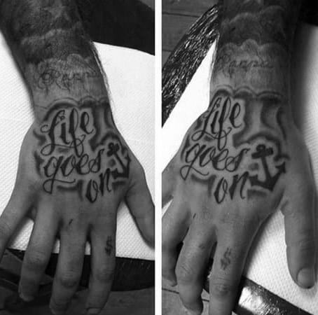 Guy With Life Goes On Hand Tattoo Design