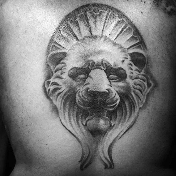 Guy With Lion Statue Back Tattoo Design