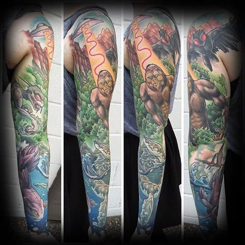 Guy With Loch Ness Monster Tattoo Design Full Arm Sleeve