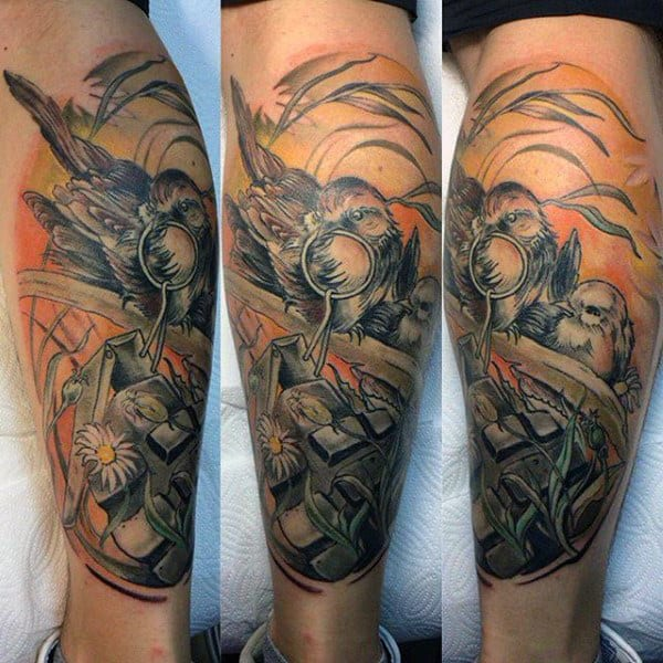 Guy With Magnificient Sparrow Tattoo On Lower Legs