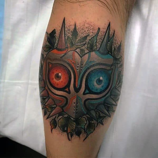 Guy With Majoras Mask Tattoo Design On Leg Calf