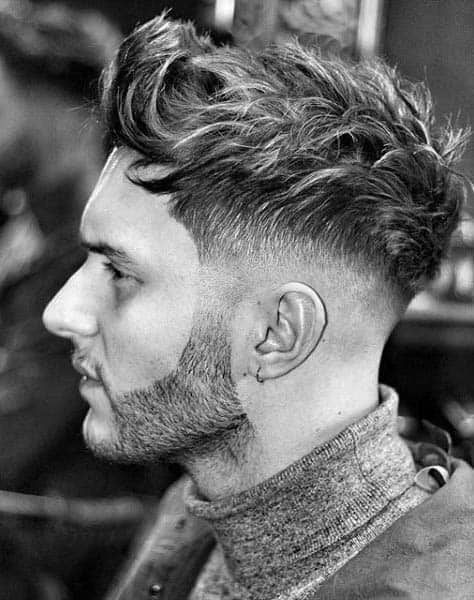 Guy With Medium Hair Wavy Low Fade