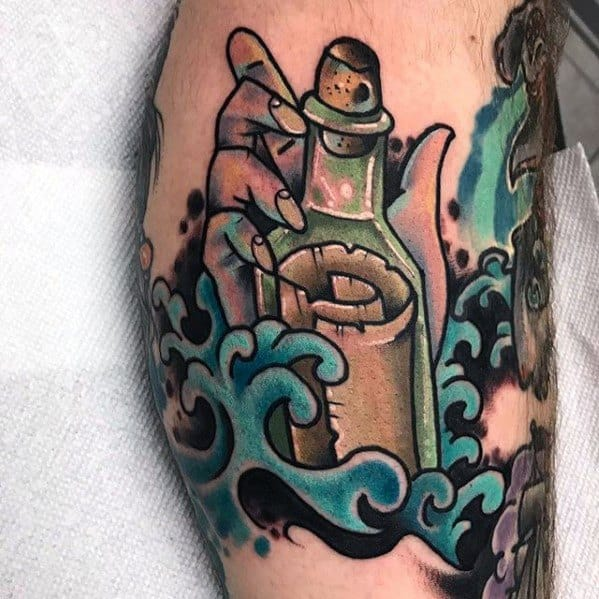 Guy With Message In A Bottle Tattoo Design On Leg