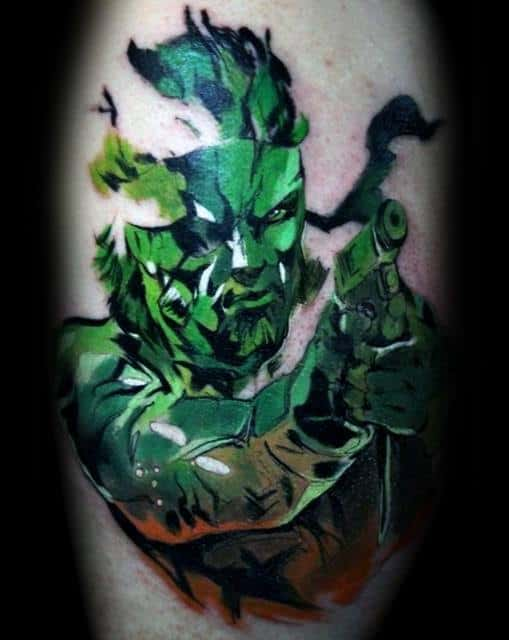 Guy With Metal Gear Tattoo Design Green And Orange Ink Leg Calf