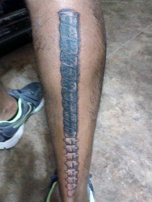 Guy With Metallic Golf Club Tattoo On Calves