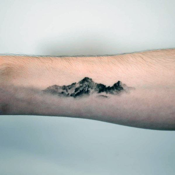 Guy With Minimalist Mountain Tattoo