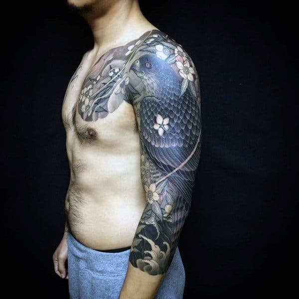 Guy With Modern Full Sleeve And Shoulder Tattoo Of Hawk Adorned With Flowers