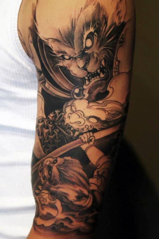 Guy With Monkey King Black Ink Shaded Half Sleeve Tattoo